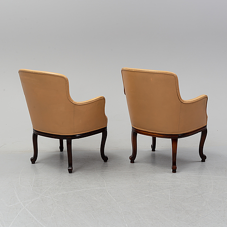 A pair of leather opholstered lounge chairs from 1927, nordiska kompaniet.