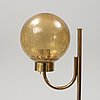 Bergboms, a pair of model 'g-118', brass and glass floor lamps. second half of the 20th century.