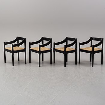 "Vico Magestretti. Four black lacquered chairs with rope seats, ""Carimate"". Cassina, Italy."