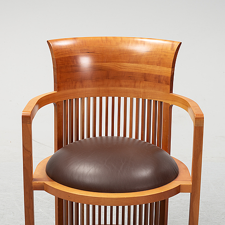 A model 606 'barrel' chair by frank lloyd wright for cassina, designed 1937.