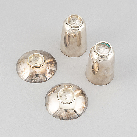 Sigvard bernadotte, two beakers and two ashtrays, copenhagen 1945-77, sterling silver, design nr 825a and 825.
