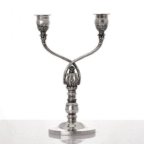 Johan rohde, a sterling silver two branched candelabrum, georg jensen, copenhagen 1945-77, design nr 343.
