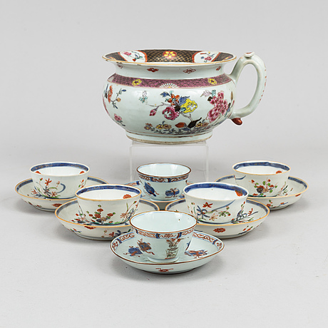 Six famille rose and imari cups with dishes and a jug, qing dynasty, 18th century.
