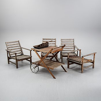Four armchairs, a table and a grill, by Elsa Stackelberg for Friform, second half of the 20th Century.