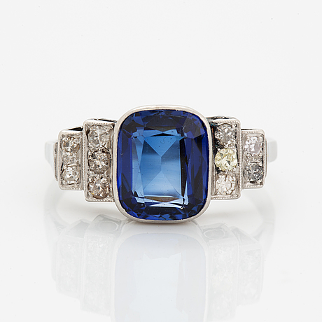 Synthetic sapphire and diamond ring.