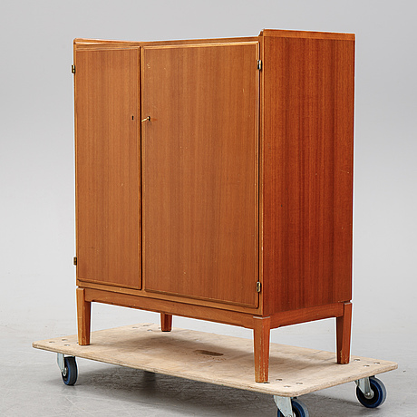 A mahogany cabinet from nordiska kompaniet, dated 1952.