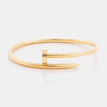 """367. A Cartier """"Juste en Clou"""" bracelet in 18K gold."""