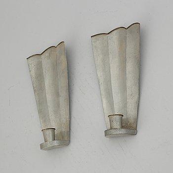 Firma Svenskt Tenn, a pair of pewter and brass wall sconces, Sweden 1925.
