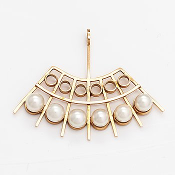 A 14K gold pendant with cultured pearls. Helsinki 1964.
