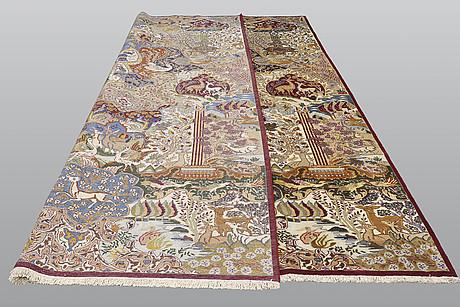 A carpet, figural kashmar, ca 398 x 303 cm.