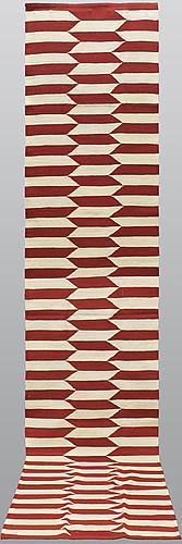 A runner, flat weave, ca 397 x 83 cm.
