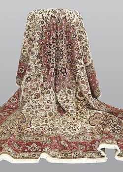 A carpet, Tabriz part silk, so called 50 Raj, cm 400 x 300 cm.