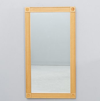 A Fröseke 1970s oak and leather mirror.
