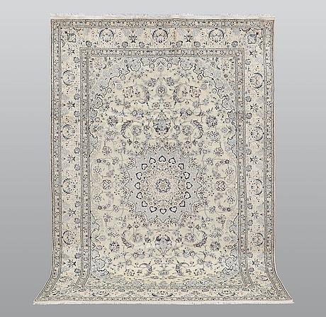 A carpet, nain part silk, ca 295 x 197 cm.