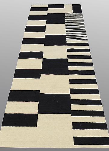 A runner, flat weave, ca 296 x 78 cm.