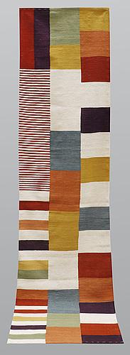 A runner, flat weave, ca 335 x 85 cm.