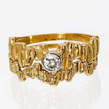2 rings 18K gold, 1 brilliant-cut diamond approx 0,20 ct.
