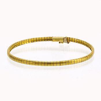 Bangle, semi-rigid, 14K gold, 8,6 g, approx 18 x 0,3 cm.