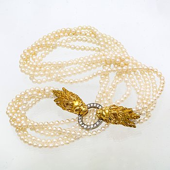 Necklace 5 rows cultured Pearls approx 3 mm, clasp 18K gold w 14 brilliant-cut diamonds 0,28 ct in total.
