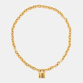 """368. A Tiffany lock charm pendant necklace """"1837"""" in 18K gold."""