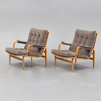 A pair of easy chairs by Bruno Mathsson for Dux, designed 1969.