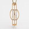 Elis kauppi, a 14k gold necklace with a rutile quartz. kupittaan kulta, turku.