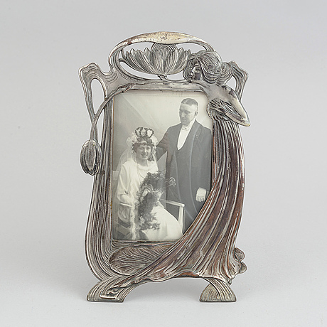 A pair of silver plated art noveau photo frames. early 20th century.