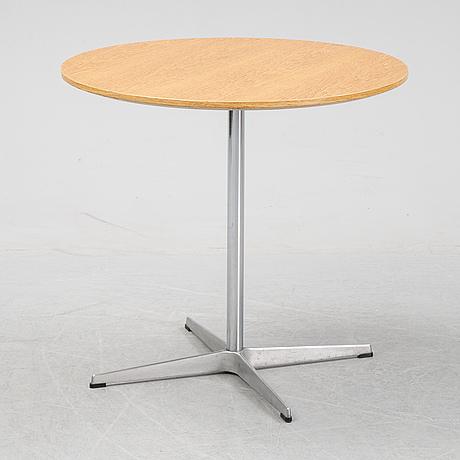 Arne jacobsen. an oak vennered table, model a622, fritz hansen, denmark, 2008.