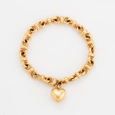 Jarl sandin armband 18k guld med en rund briljantslipad diamant ca 0.03 ct.