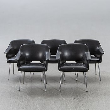 A set of five 1960s leather easy chairs.