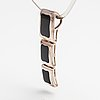 A silver and onyx necklace.