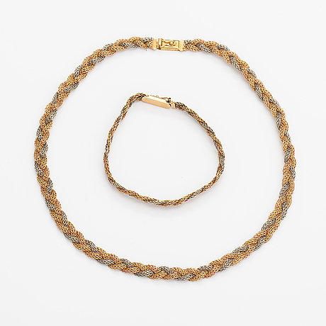 An 18k white, yellow and red gold necklace and bracelet. italy.