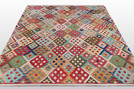 A carpet, kilim, ca 297 x 201 cm.