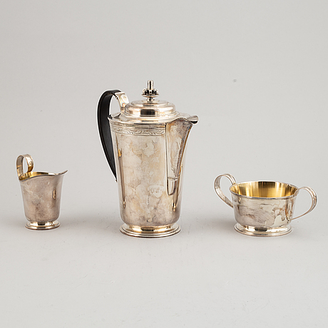 A three peice silver coffee servicedesigned by tore eldh, k&ec, 1949.