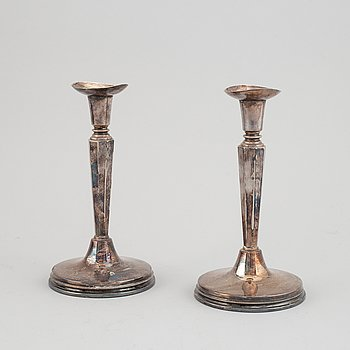 A pair of silver candle holders, MGAB, 1966.