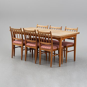 A Carl Malmsten dining group, table and six chairs, second half of the 20th century.