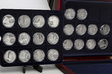 A 20th century set of 22  danish silver medals.