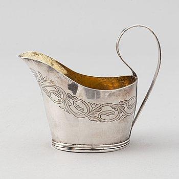 A parcel-gilt silver creamer, mark of Johan Henrik Lampa, Stockholm 1813.