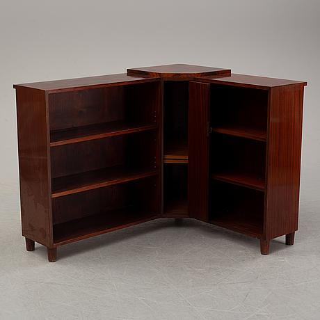 A corner bookcase, mid 19th century.