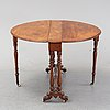 A neo-renaissance mahogany drop-leaf table from secord half of 19th century.