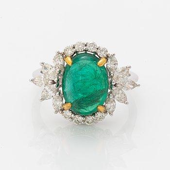 Cabochon-cut emerald and diamond ring.