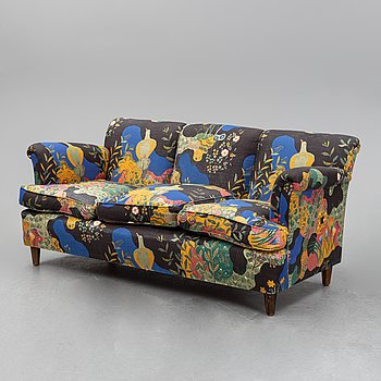 A model 678 sofa by Josef Frank for Firma Svenskt Tenn.