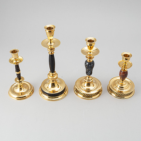 After. four brass and stone candlesticks from skultuna, numbered 144/300, 1997.