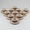 "Ulla procopé. a set of 11 tea cups and saucers, ""koralli"", arabia."