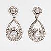 A tillander, a pair of 18k gold earrings with brilliant cut diamonds ca. 3.95ct in total. helsinki 2001.