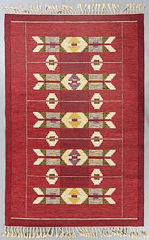 A Swedish flatweave carpet signed IS (I SIlow) ca 242 x 169 cm.