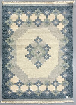 A Swedish flatweave carpet signed ILS ca 236 x 171 cm.