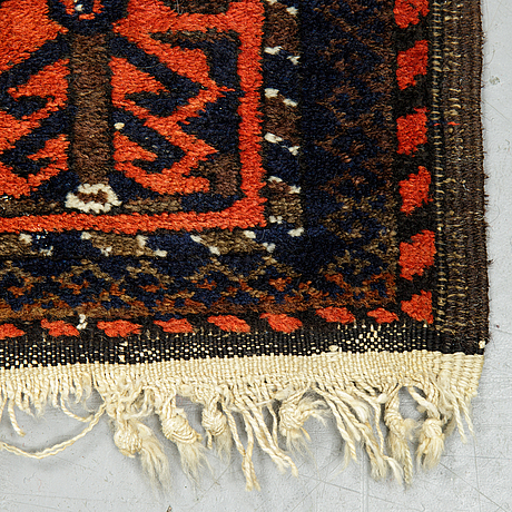 A rug, a semi-antique baluch, ca 166 x 92 cm.