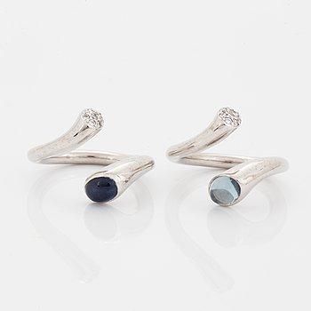 """Georg Jensen, två ringar, """"Carnival"""", med cabochonslipad safir och akvamarin och briljantslipade diamanter."""