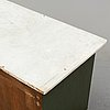 A painted chest of drawers, mid 19th century.
